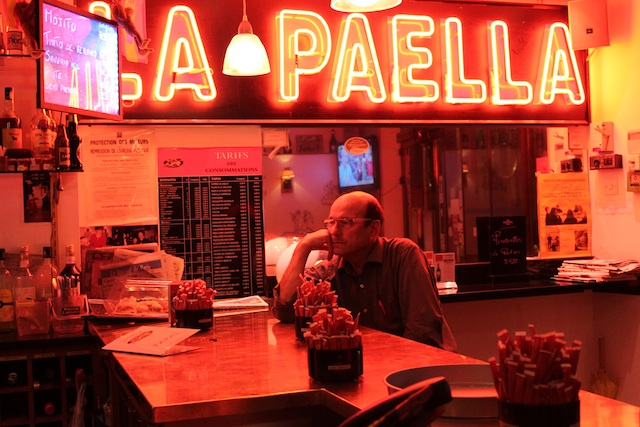 Man in La Paella by Gare du Nord