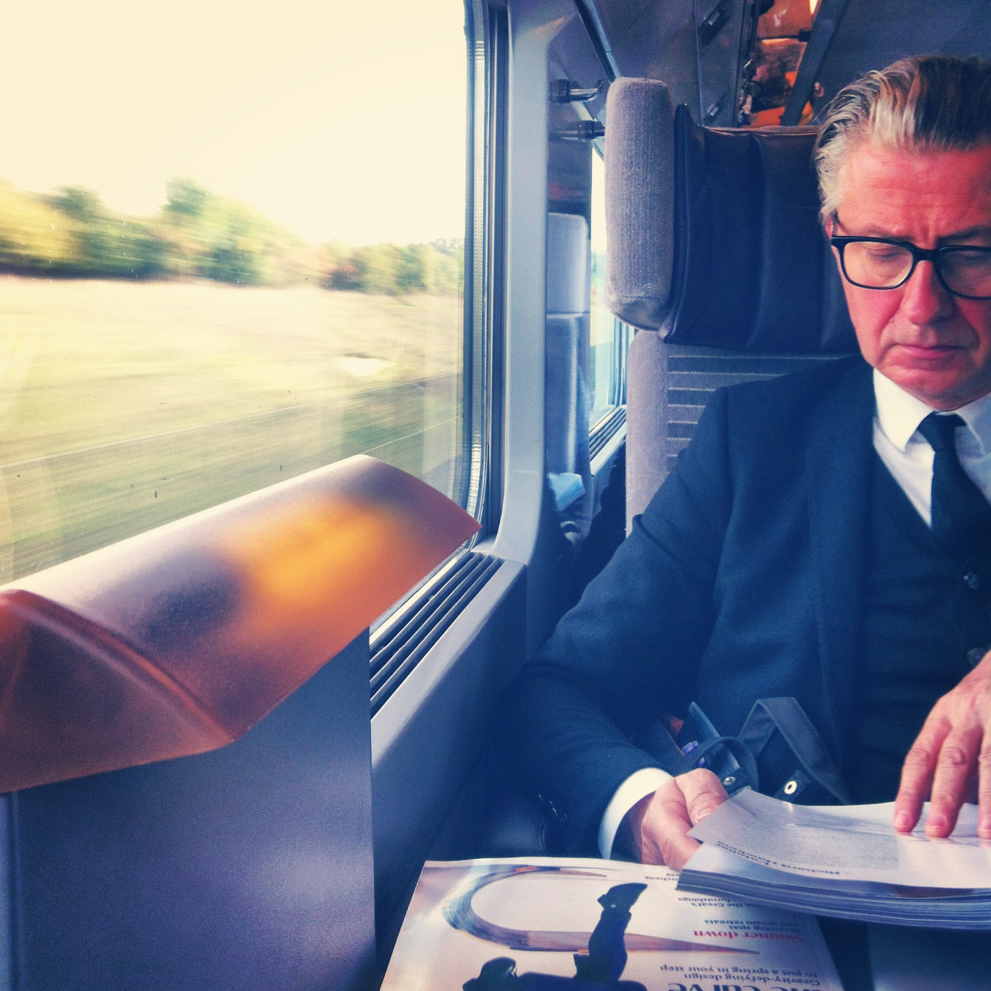 A Parisian in a sharp suit on the Eurostar